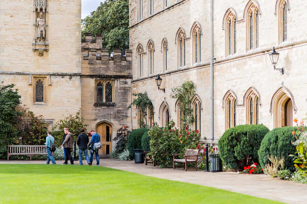 Students walking across campus at Oxford